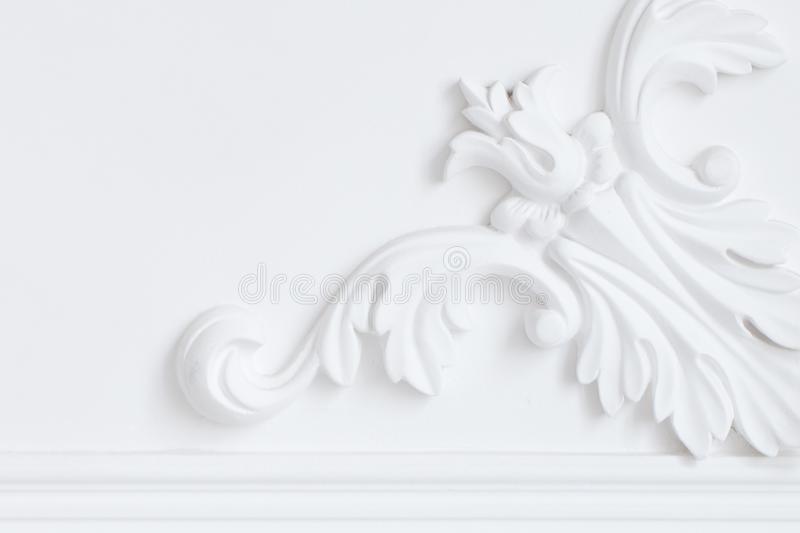Beautiful ornate white decorative plaster moldings in studio.  stock images