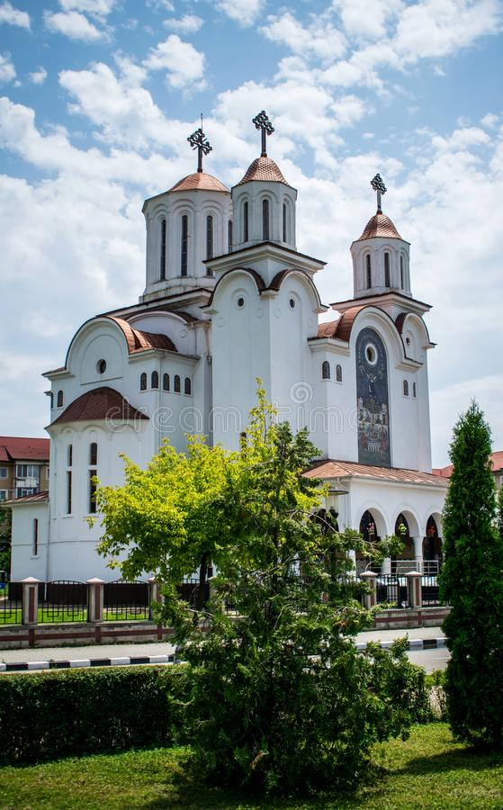 A beautiful Orthodox cathedral in romania. Architecture of Orthodox Churches. In Europe. Beautiful blue sky with fluffy clouds, grass and trees royalty free stock photography
