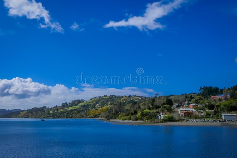 Beautiful outdoor landscape of some house buildings located at palafitos in Castro, Chiloe Island, Patagonia. Chile in goegeous sunny day royalty free stock photo
