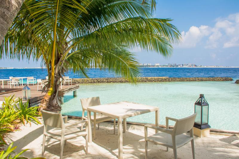 Beautiful outdoor restaurant at the beach at the topical island stock photography