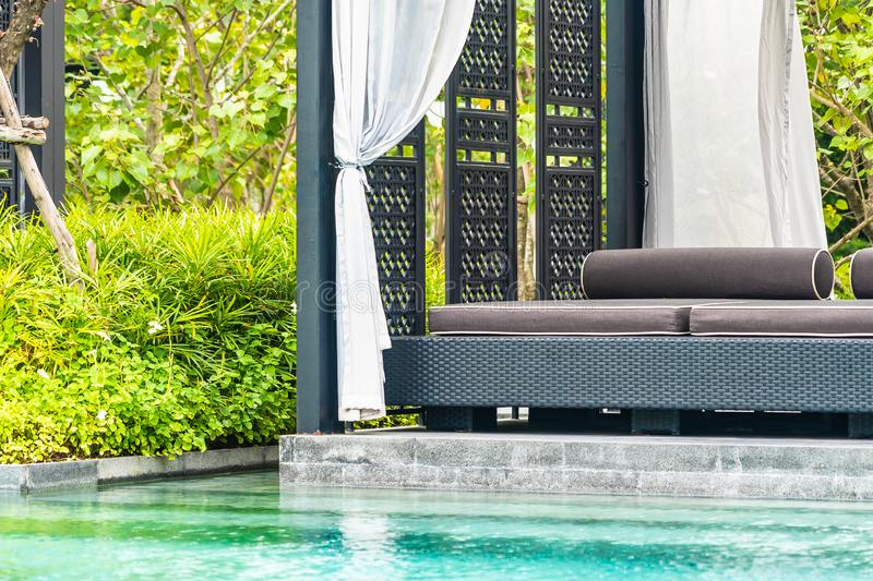 Beautiful outdoor swimming pool in hotel and resort with chair and deck for leisure vacation. And travel royalty free stock image