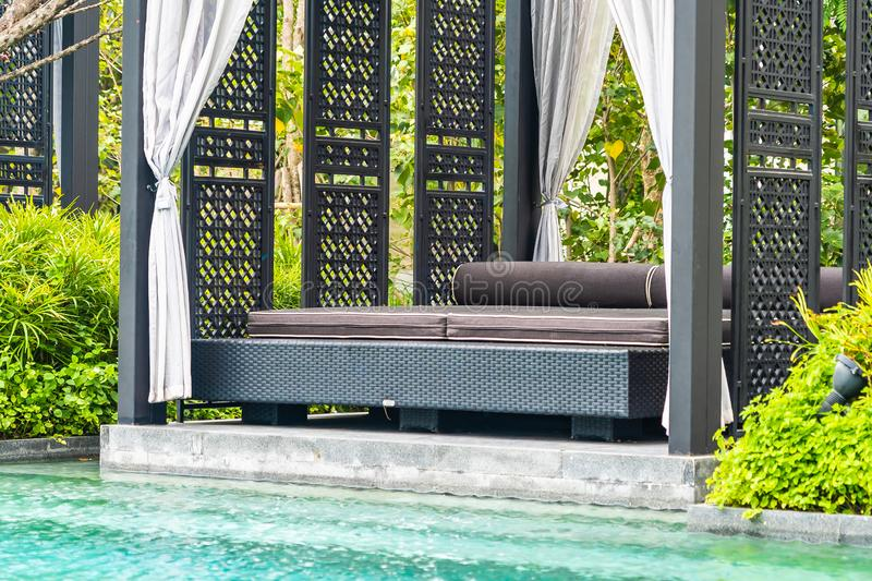 Beautiful outdoor swimming pool in hotel and resort with chair and deck for leisure vacation. And travel stock image