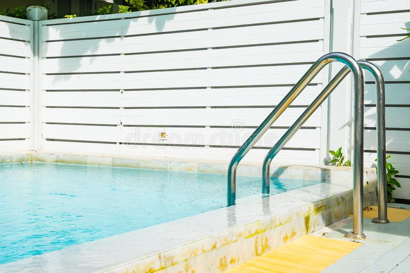 Beautiful outdoor swimming pool in hotel resort with stair. For leisure relax in holiday vacation stock photos