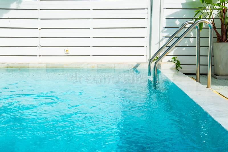 Beautiful outdoor swimming pool in hotel resort with stair. For leisure relax in holiday vacation stock image