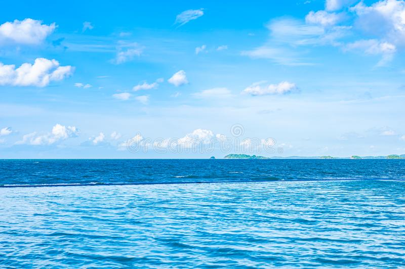 Beautiful outdoor swimming pool in hotel resort with white cloud and blue sky for leisure relax. In holiday vacation royalty free stock photos