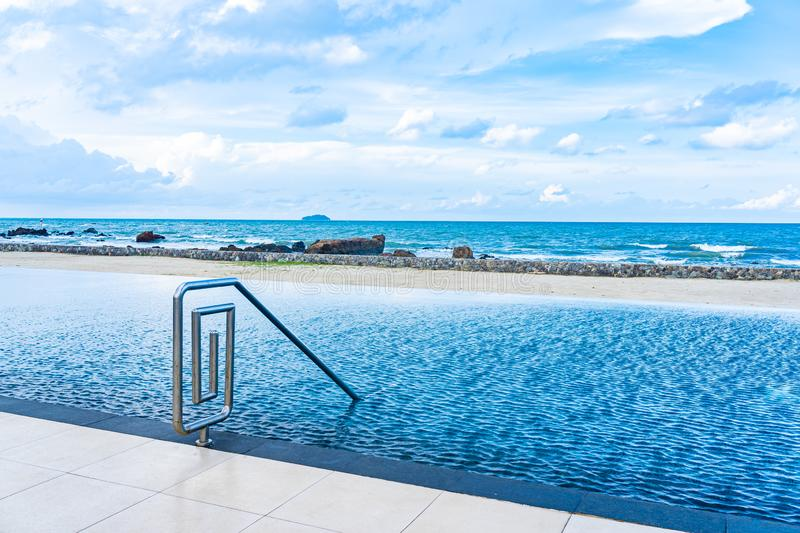 Beautiful outdoor swimming pool in hotel resort with white cloud and blue sky for leisure relax. In holiday vacation stock photos