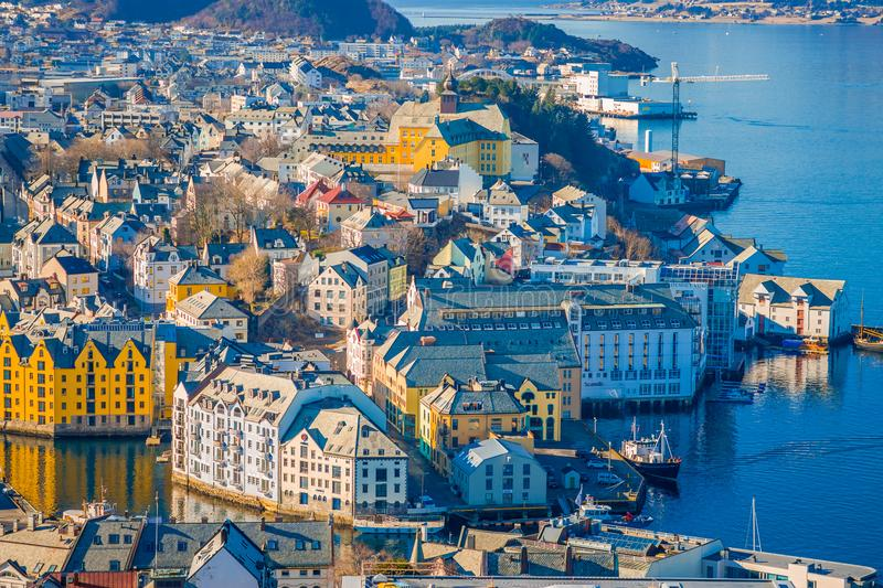 Beautiful outdoor view of colorful buildings from the mountain Aksla at the city of Alesund, Norway.  stock photo