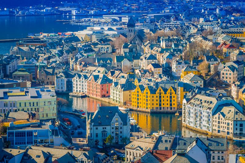 Beautiful outdoor view of colorful buildings from the mountain Aksla at the city of Alesund, Norway.  royalty free stock photo