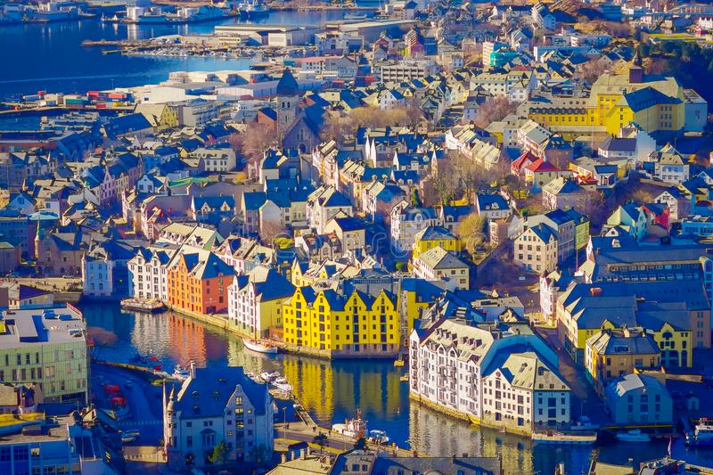 Beautiful outdoor view of colorful buildings from the mountain Aksla at the city of Alesund, Norway.  stock photography