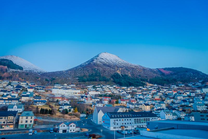Beautiful outdoor view of colorful buildings from the mountain Aksla at the city of Hurtigruten with two huge mountains. Behind, Norway royalty free stock image