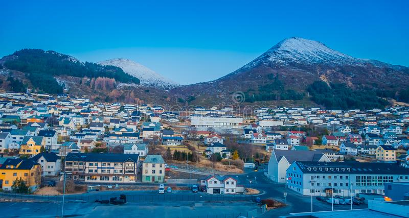 Beautiful outdoor view of colorful buildings from the mountain Aksla at the city of Hurtigruten with two huge mountains. Behind, Norway stock photos