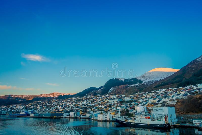 Beautiful outdoor view of colorful buildings from the mountain Aksla at the city of Hurtigruten with two huge mountains. Behind, Norway stock images