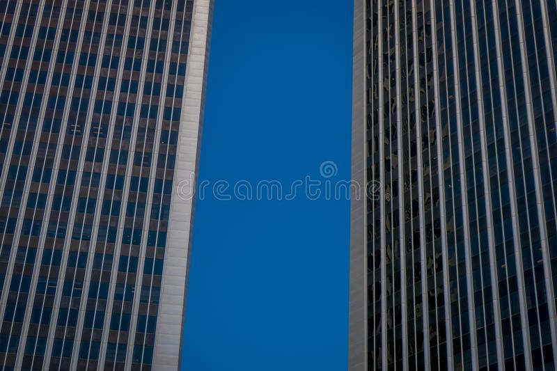 Beautiful outdoor view of two huge buildings in a gorgoues sunny day and blue sky background, located in Downtown LA Los. Angeles skyline cityscape California stock images