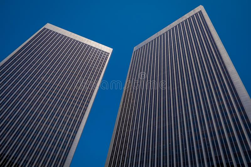 Beautiful outdoor view of two huge buildings in a gorgoues sunny day and blue sky background, located in Downtown LA Los. Angeles skyline cityscape California stock photography