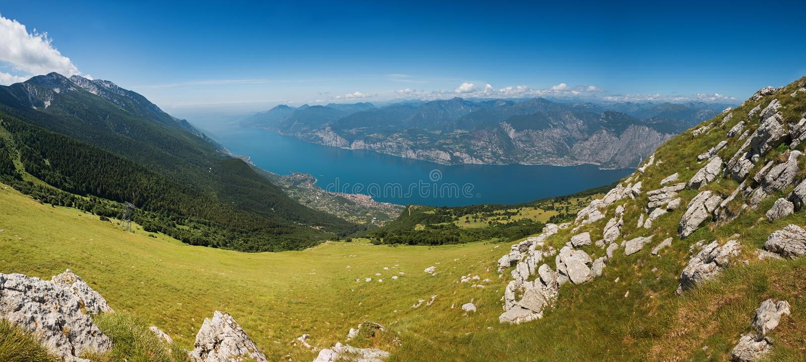 Beautiful outlook from the top of monte baldo mountain, italy. Beautiful outlook to garda lake from the top of monte baldo mountain, north italy royalty free stock images