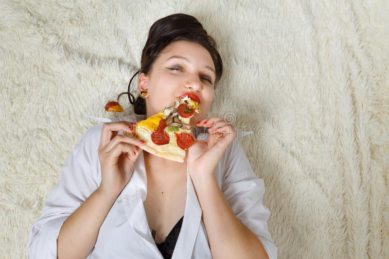 Woman with pizza stock photos