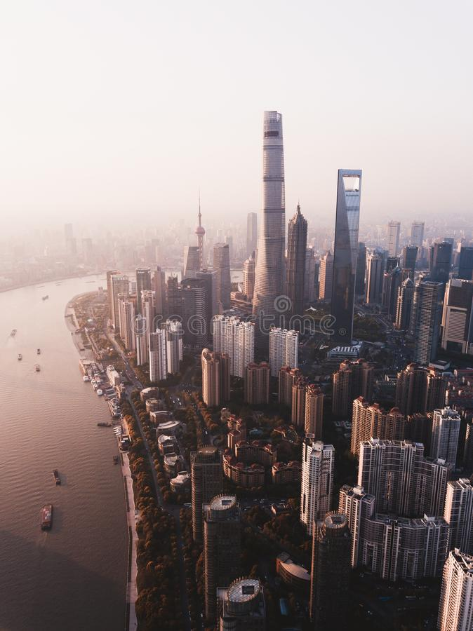 Beautiful overhead shot of Shanghai city skyline with tall skyscrapers and a river on the side. A beautiful overhead shot of Shanghai city skyline with tall royalty free stock photography