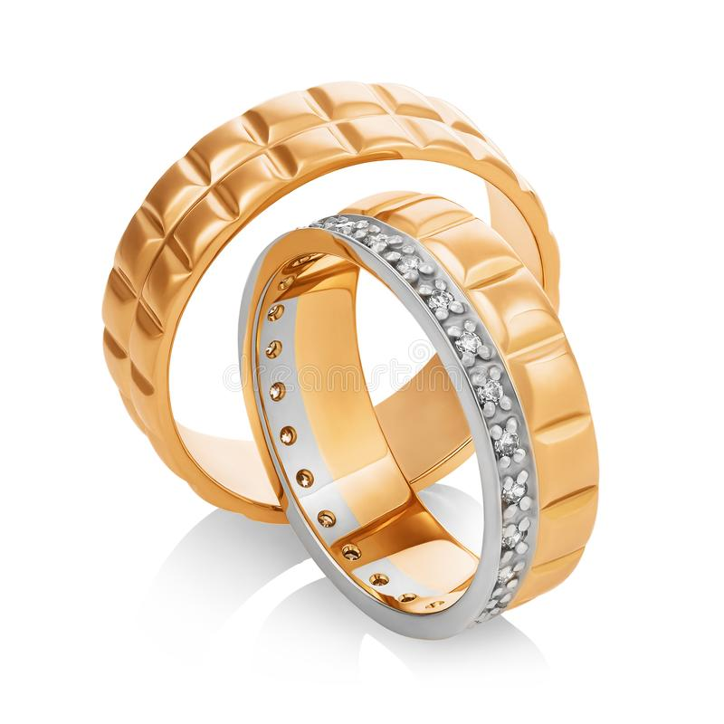 Beautiful pair of gold wedding rings with diamonds isolated on white background. Photo was taken by stacking. Beautiful pair of gold wedding rings with diamonds royalty free stock photos