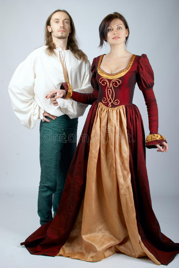 Beautiful pair of medieval costumes royalty free stock image