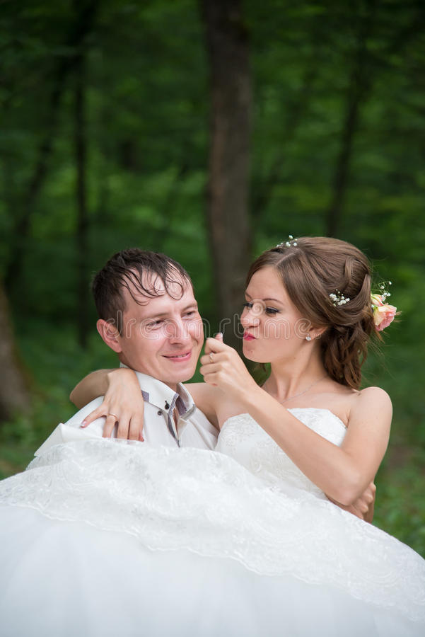 Beautiful pair of newlyweds on a walk. Beautiful married couple in the wedding day stock photography