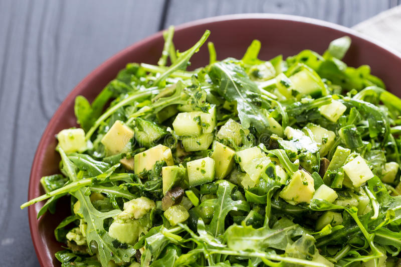 Beautiful Paleo Green Salad with Cucumber and Avocado on a Dark Grey Wooden Background, Horizontal royalty free stock images