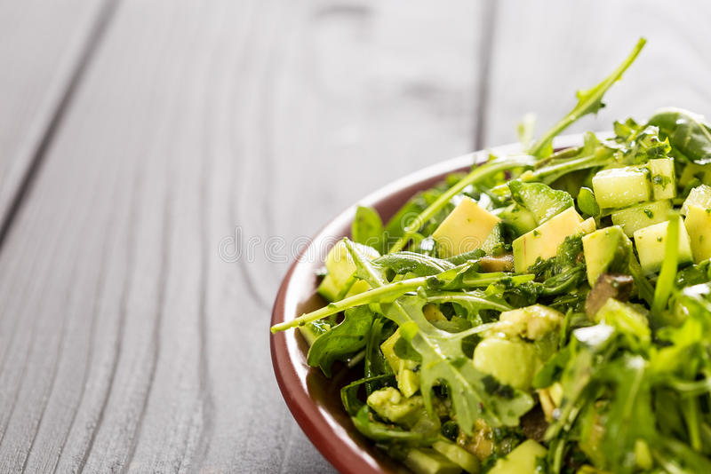 Beautiful Paleo Green Salad with Cucumber and Avocado on a Dark Grey Wooden Background, Horizontal, Close-up, Free Space for Text stock photography