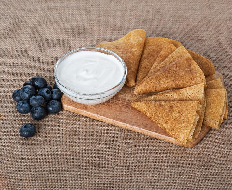 Pancakes with berries on burlap royalty free stock photos