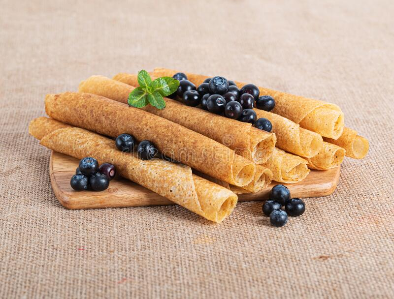 Pancakes with berries on burlap royalty free stock photo