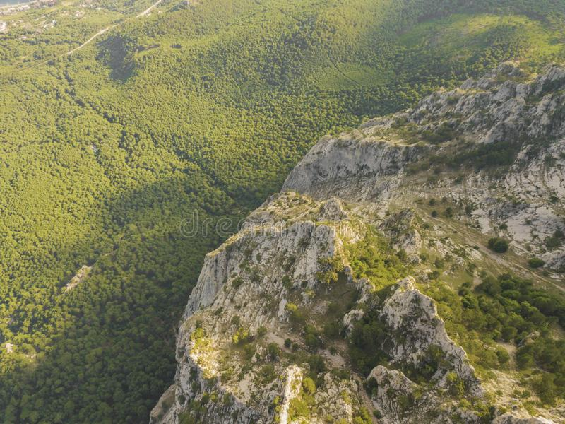 Beautiful panorama aerial view of high mountains covered with green summer forest b stock image