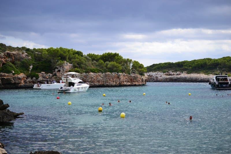 Rock formations for climbing at Cala Sa Nau beach and Cala d`Or city, Palma Mallorca Island, Spain stock images