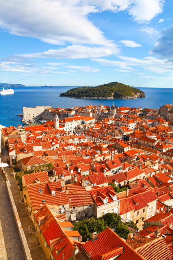 Beautiful panorama of Dubrovnik, Croatia. View of many landmarks of Old town in city of Dubrovnik, Croatia. Classic red tiled rooftops with Adriatic sea and stock photography