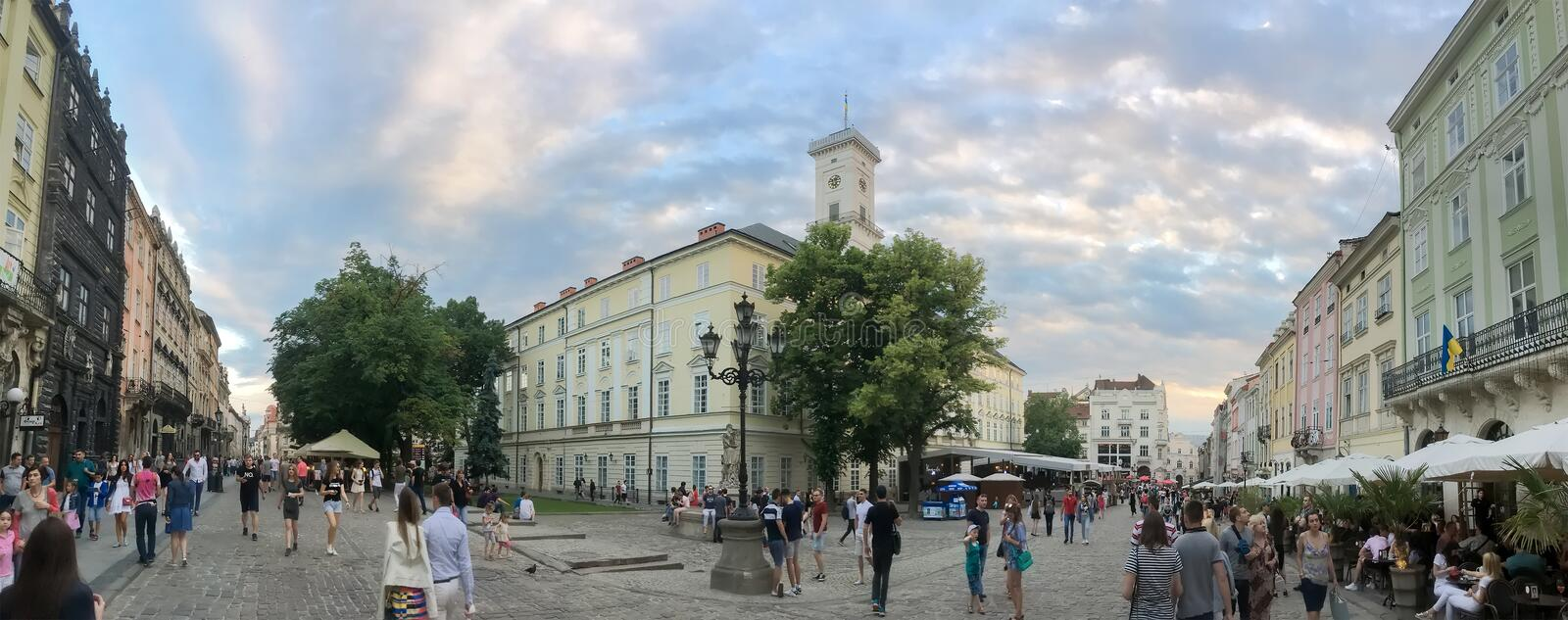Beautiful panorama of evening Lviv - walking and resting people stock images