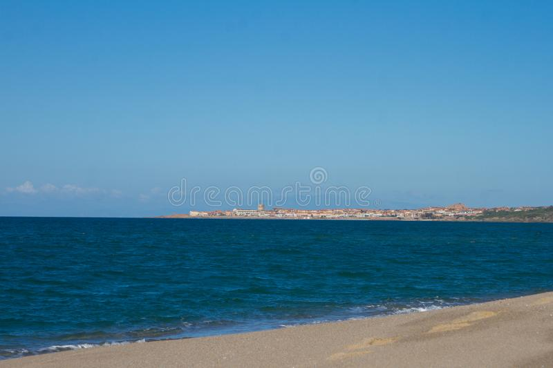 Beautiful panorama of the famous beaches of the Sardinian sea with the isola rossa and castelsardo  behind royalty free stock photos