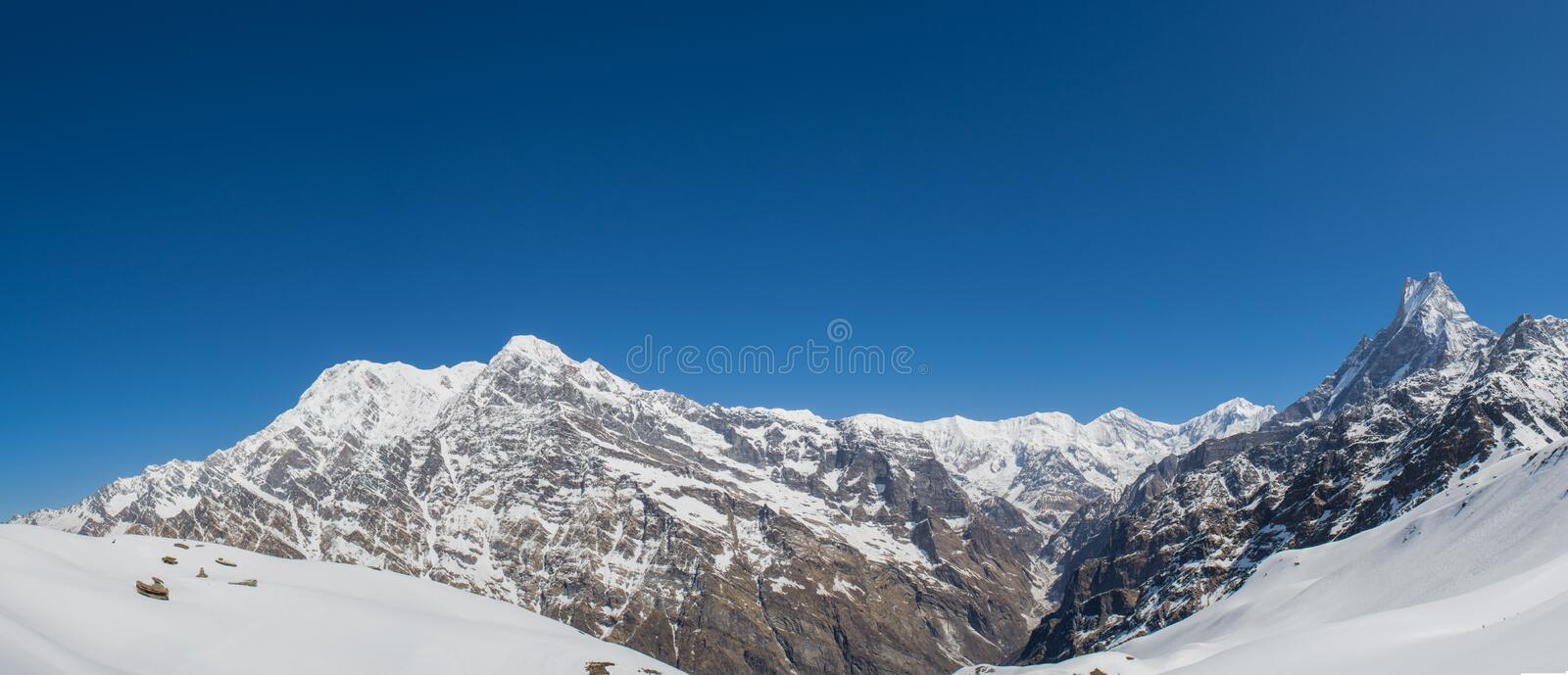 Beautiful  landscape view of Himalaya mountains covered with snow at Mardi Himal trekking area. Beautiful panorama landscape view of Himalaya mountains covered royalty free stock photos