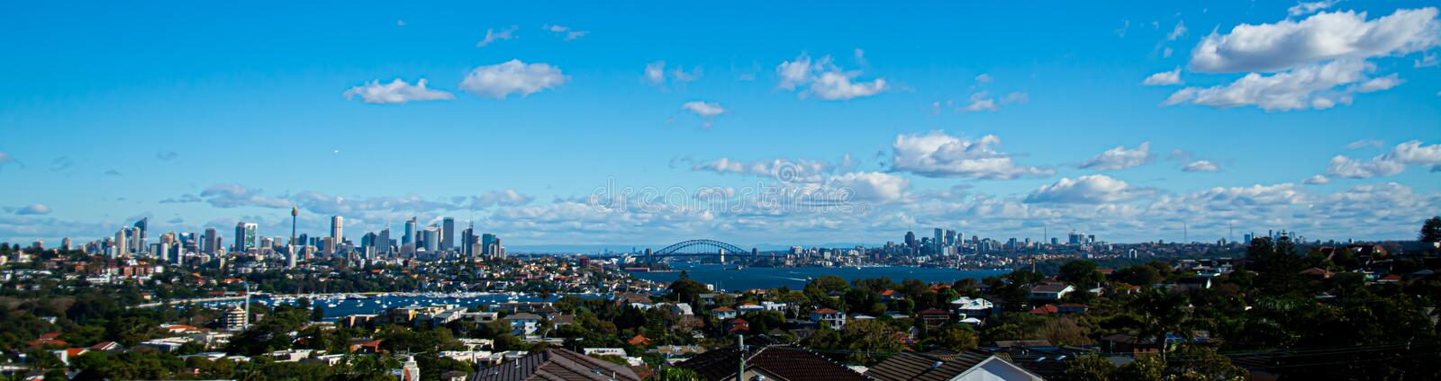Beautiful panorama of a modern city with skyscrapers under a bright blue sky royalty free stock images
