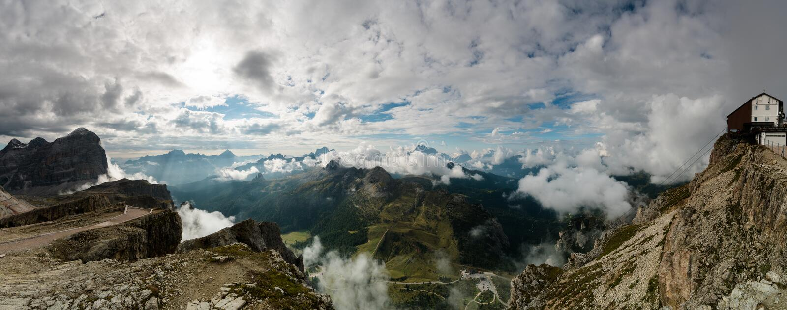 Beautiful panorama mountain landscape with a cable railway station and a great view of the Dolomites in Alta Badia and many hikers stock image