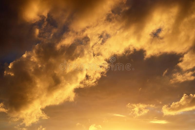 Beautiful panorama of orange and yellow clouds at sunrise/sunset on a blue sky in high resolution stock photo