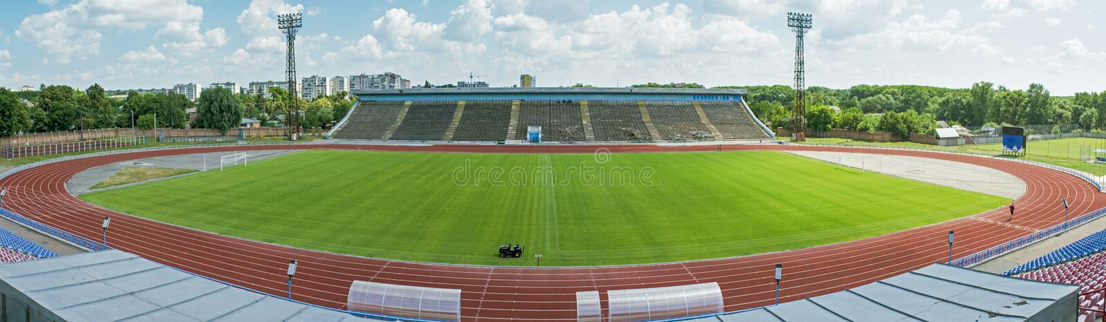 Beautiful panorama photo of soccer stadium during sunny day in Chernihiv town stock image
