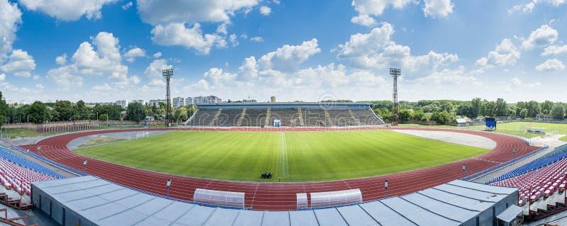 Beautiful panorama photo of soccer stadium during sunny day royalty free stock image