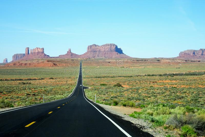 Beautiful panorama road on the way to the Monument Valley in Utah, USA. Beautiful Road on the way to the Monument Valley in Utah, USA royalty free stock images