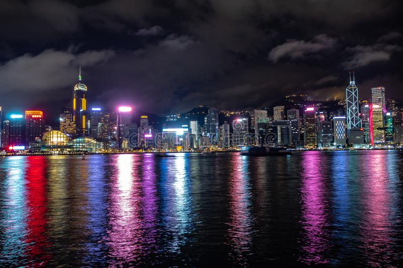 Beautiful panorama scene of hong kong city midtown at night with skyscrapers illuminated reflecting in the river stock photos