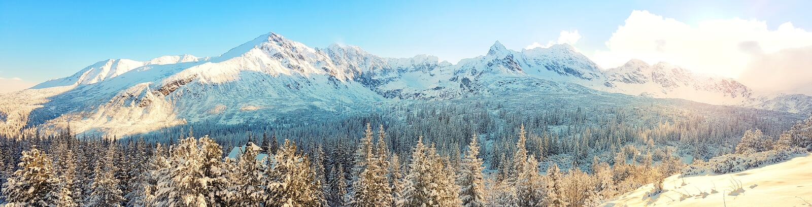 Beautiful panorama of snow-capped mountain range , the sun shines in the morning stock image