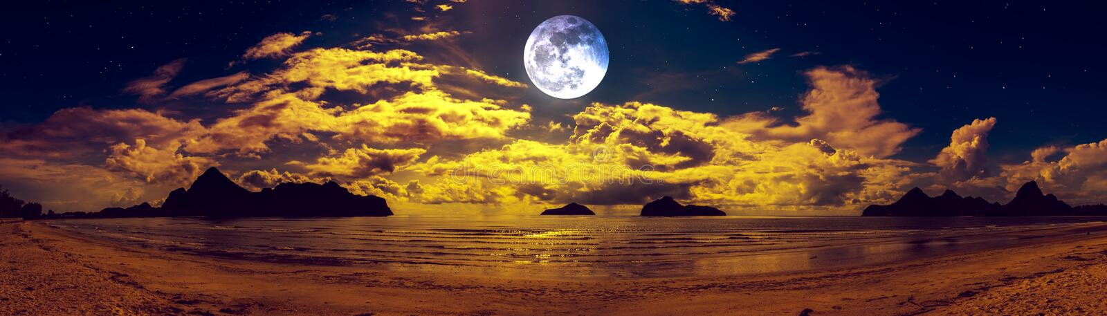 Beautiful panorama view of the sea. Colorful blue sky with cloud and bright full moon on seascape to night. Serenity nature background, outdoor at nighttime stock photo