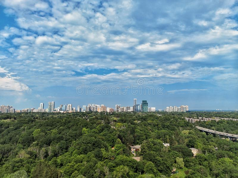 Panoramic landscape aerial top view of summer day in Toronto city, North York, Canada. Blue sky with white clouds, green park. Beautiful panoramic landscape royalty free stock images