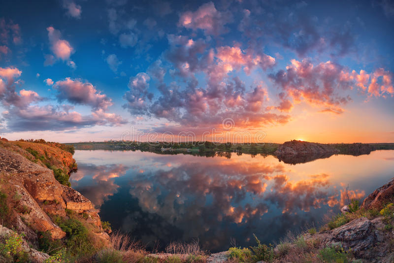 Beautiful panoramic landscape with colorful cloudy sky, lake and royalty free stock photo