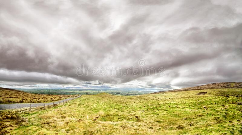 Beautiful panoramic landscape with dramatic clouds in the south west of Ireland stock image