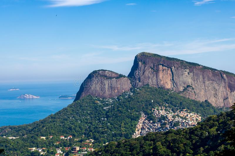 Beautiful PANORAMIC landscape with rainforest, city district Leblon, Ipanema, Botafogo, Lagoon Rodrigo de Freitas and mountains. Corcovado, sugarloaf, two royalty free stock photography