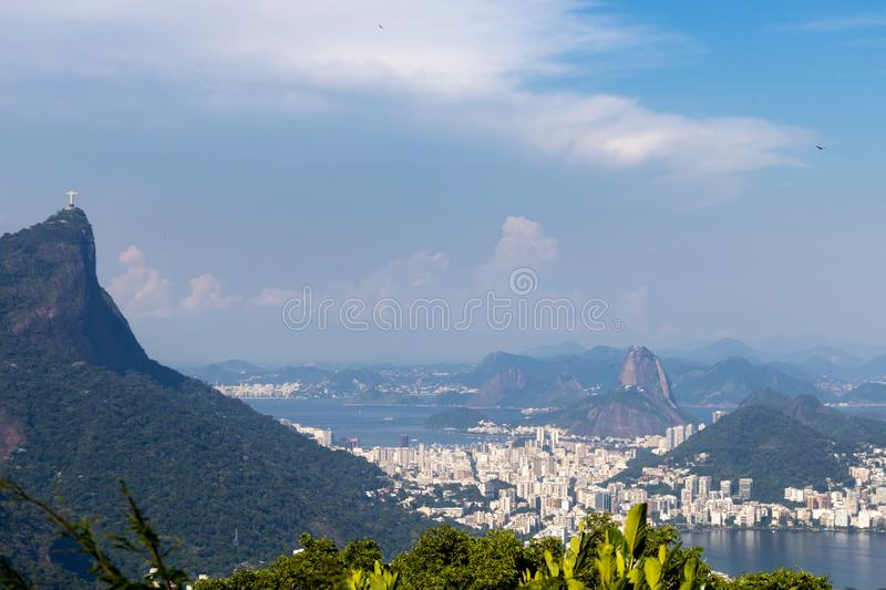 Beautiful PANORAMIC landscape with rainforest, city district Leblon, Ipanema, Botafogo, Lagoon Rodrigo de Freitas and mountains. Corcovado, sugarloaf, two stock images