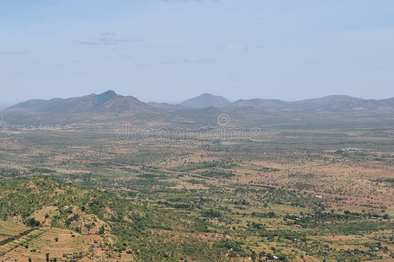 Beautiful panoramic mountain ranges in the arid landscapes of rural Kenya, stock photography