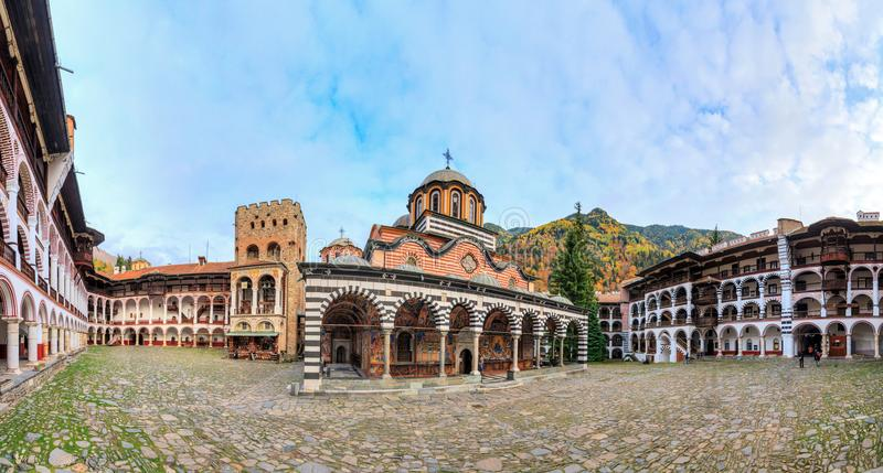 Rila monastery panorama. Beautiful panoramic panorama of the Orthodox Rila Monastery, a famous tourist attraction and cultural heritage monument in the Rila stock images